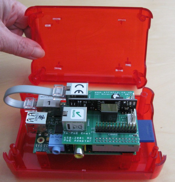 Adapter and Pi PCBs mounted in a red plastic box