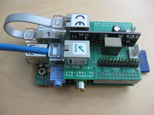 A picture of the Raspberry Pi PoE Adapter PCB mounted on a Pi PCB - top